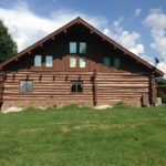 BEFORE: Painted Log Home to be Restored